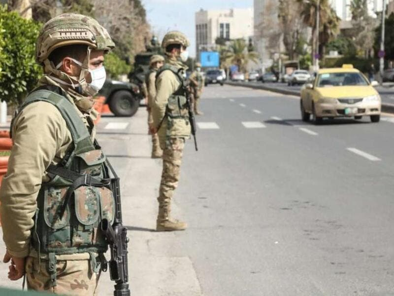Jordanian army soldiers deployed at entrances and exits of main cities to enforce COVID-19 confinement measures. (AFP)