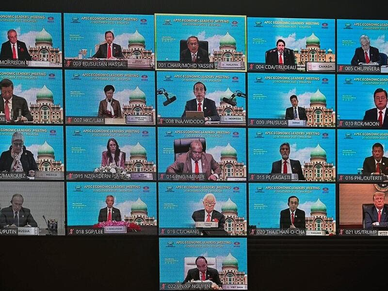 A screen shows the virtual meeting between world leaders, including US President Donald Trump (bottom R), Russian President Vladimir Putin (bottom L) and Chinese President Xi Jinping (L, second row from top), during the online Asia-Pacific Economic Cooperation (APEC) leaders' summit in Kuala Lumpur on November 20, 2020. MOHD RASFAN / AFP