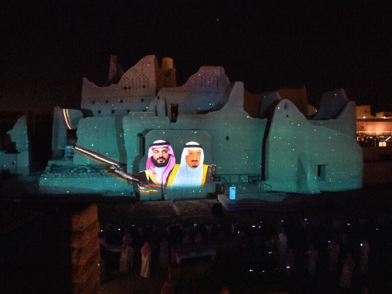A picture of Saudi King Salman bin Abdulaziz (R) and his son Crown Prince Mohammed bin Salman is projected at the historical site of al-Tarif in Diriyah district, on the outskirts of Saudi capital Riyadh, on November 20, 2020. Saudi Arabia hosts the G20 summit on November 21 in a first for an Arab nation, with the downsized virtual forum dominated by efforts to tackle a resurgent coronavirus pandemic and crippling economic crisis. FAYEZ NURELDINE / AFP
