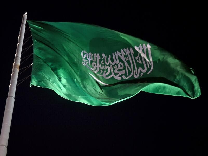 The Saudi national flag flutters at the historical site of al-Tarif in Diriyah district, on the outskirts of Saudi capital Riyadh, on November 20, 2020. Saudi Arabia hosts the G20 summit on November 21 in a first for an Arab nation, with the downsized virtual forum dominated by efforts to tackle a resurgent coronavirus pandemic and crippling economic crisis. FAYEZ NURELDINE / AFP
