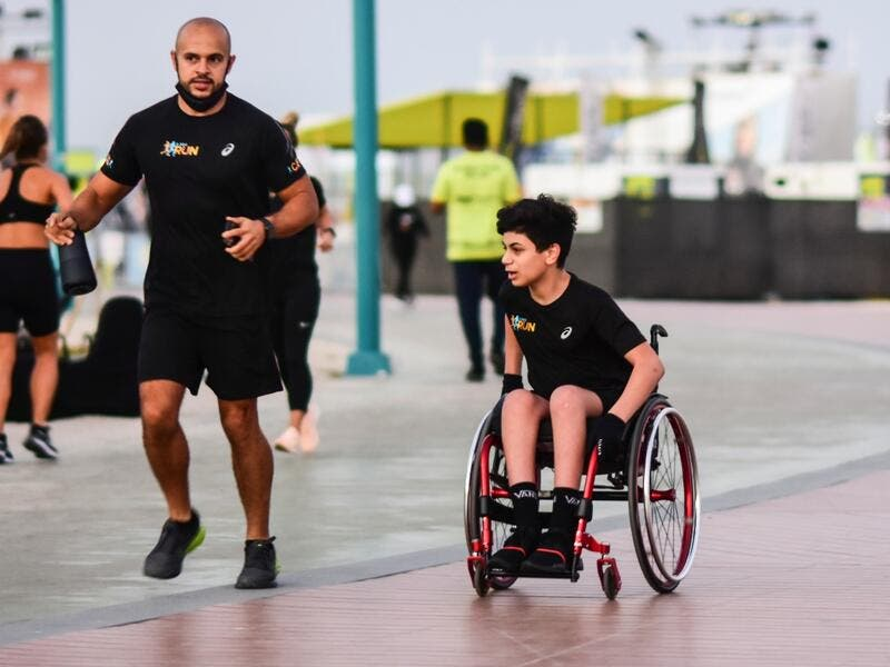 The teen, who is wheelchair-bound, was one of the first few to reach Kites Beach at around 5am to take part in the Dubai Run. (Twitter)