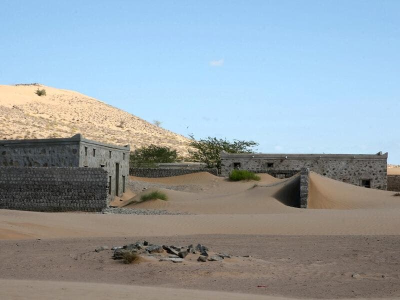 This picture taken on December 31, 2020, shows abandoned houses in the Omani village of Wadi al-Murr, about 400 kms (250 miles) southwest of the capital Muscat. MOHAMMED MAHJOUB / AFP