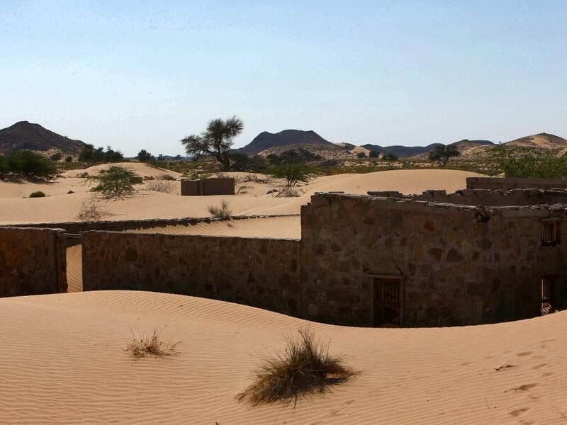 This picture taken on December 31, 2020, shows the walls of an abandoned house in the Omani village of Wadi al-Murr, about 400 kms (250 miles) southwest of the capital Muscat. Encroaching desert sands have left little evidence that Wadi al-Murr ever existed, but former inhabitants, while resigned to its destruction, are trying to preserve its memory. MOHAMMED MAHJOUB / AFP