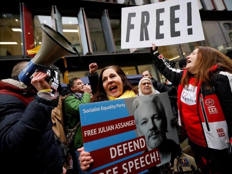 Supporters of Wikileaks founder Julian Assange celebrate outside the Old Bailey court in central London after a judge ruled that Assange should not be extradited to the United States to face espionage charges for publishing secret documents online on January 4, 2021. Tolga Akmen / AFP