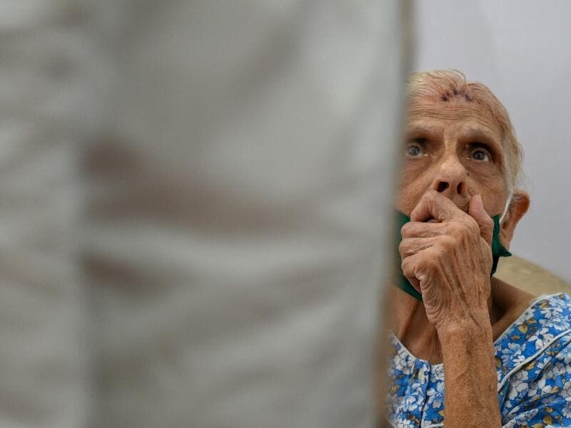 An elderly woman waits to receive a dose of the Covishield, AstraZeneca-Oxford's Covid-19 coronavirus vaccine