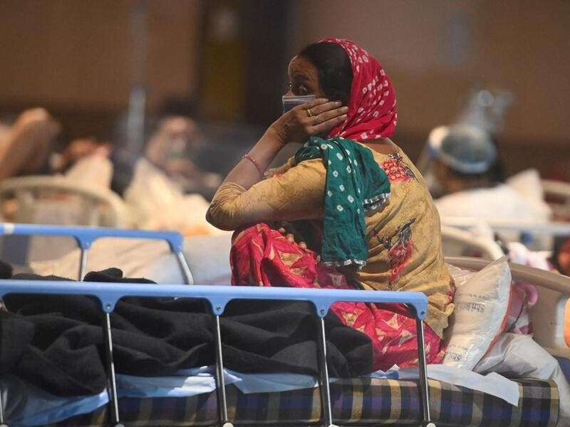 A patient rests inside a banquet hall temporarily converted into a Covid-19 coronavirus ward in New Delhi