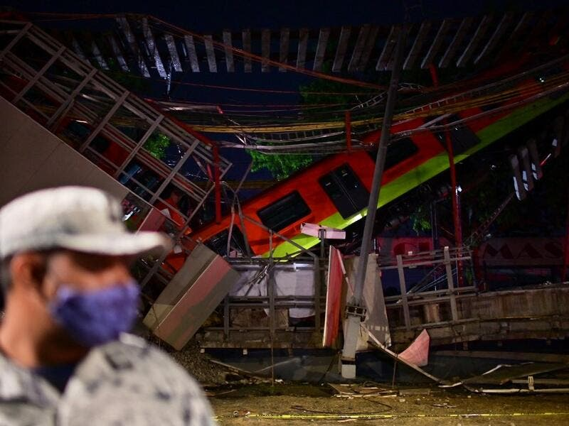 Dozens killed, wounded when an overpass carrying Mexico City metro train cars collapsed onto a roadway