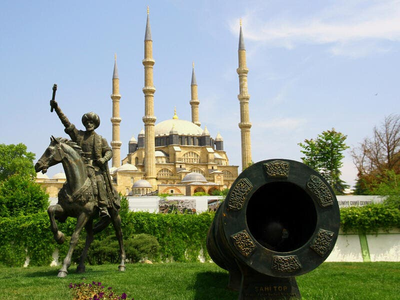 A view from the historical city center of Edirne. Selimiye Mosque, a symbolic cannonball and the monument of Ottoman empire Mehmed II,commonly known as Mehmed The Conqueror.