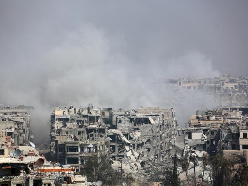 Smoke billows following Syrian government bombardment on the rebel-held besieged town of Harasta, in the Eastern Ghouta region on the outskirts of Damascus on Mar. 12, 2018. (AFP)