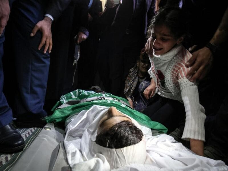 Relatives mourn over the body of Alaa al-Zamili, a teenager who died the day before from wounds sustained in clashes with Israeli forces on the border with Israel, during his funeral on Apr. 7, 2018, in the southern Gaza Strip town of Rafah. 