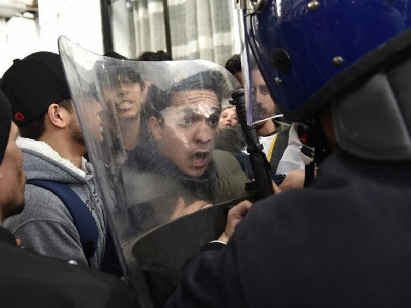 Algerian students scuffle with security forces during a protest in the capital Algiers against ailing President Abdelaziz Bouteflika's bid for a fifth term