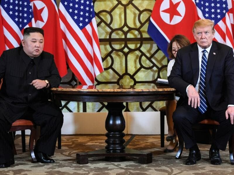 US President Donald Trump (R) and North Korea's leader Kim Jong Un hold a meeting during the second US-North Korea summit at the Sofitel Legend Metropole hotel in Hanoi on February 28, 2019. (AFP)