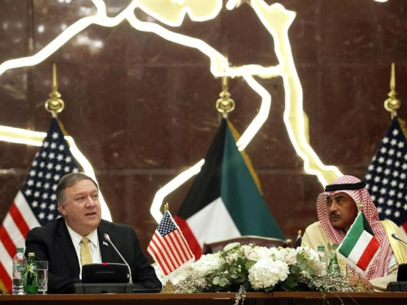 US Secretary of State Mike Pompeo (L) and Kuwait's Foreign Minister Sheikh Sabah al-Khalid al-Sabah give a joint press conference in Kuwait City on March 20, 2019.