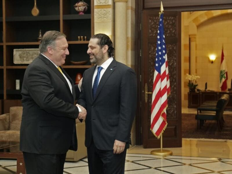 US Secretary of State Mike Pompeo (L) is welcomed by Lebanon's Prime Minister Saad Hariri (R) upon his arrival to the capital Beirut on March 22, 2019. 