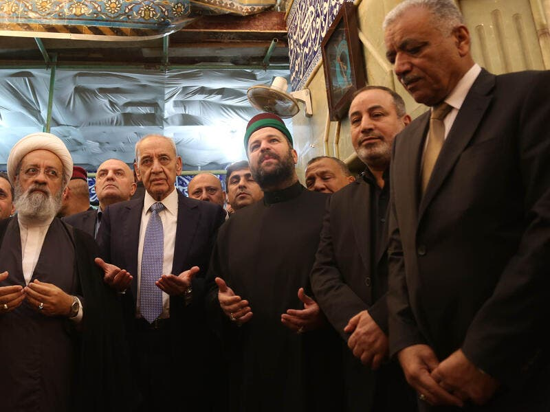Lebanese Parliament Speaker Nabih Berri (2nd-L) prays at the shrine of Imam al-Abbas in the central Iraqi holy city of Karbala on April 2, 2019. 