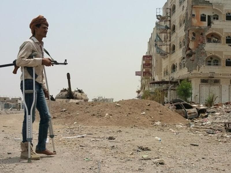 A fighter walks with crutches in Yemen's second city of Aden (AFP/File Photo)