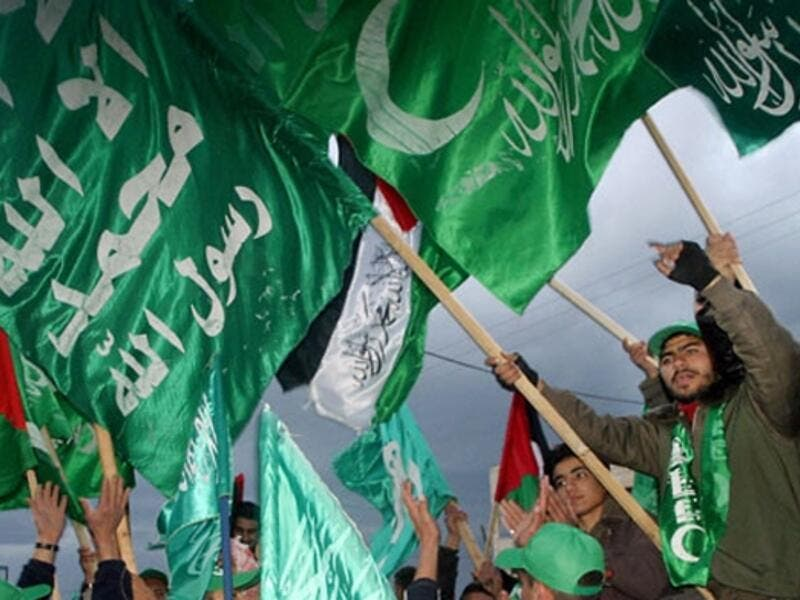 Hamas supporters wave flags during a rally in Gaza. (AFP/File)