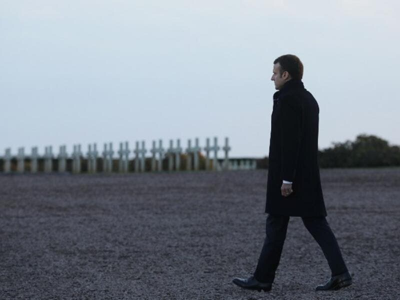 French President Emmanuel Macron takes part in a commemoration ceremony at the Notre Dame de Lorette World War I French war cemetery in Ablain-Saint-Nazaire, northern France, on November 8, 2018, as part of a World War I commemoration tour. 