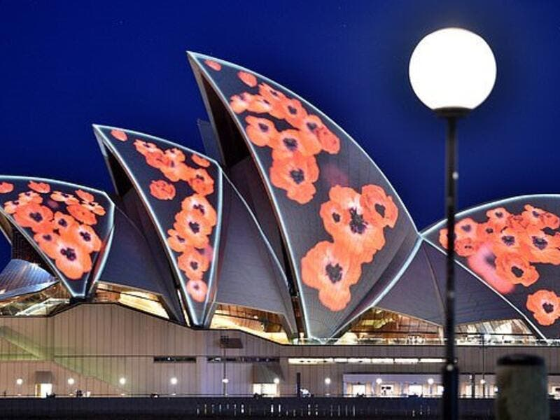 The Sydney Opera House is lit up with poppies marking the centenary of the end of World War I (AFP)