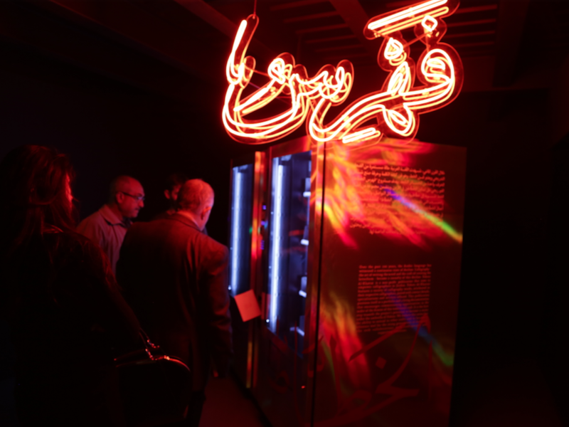 Crowdfunding through a vending machine is how Yousef Abedrabbo and Omar Al-Zo'bi are mixing modern neon lights with traditional calligraphy, at the same time as distributing the works and contacts of these professional modern scribes.  (Al Bawaba/Salim Essaid)