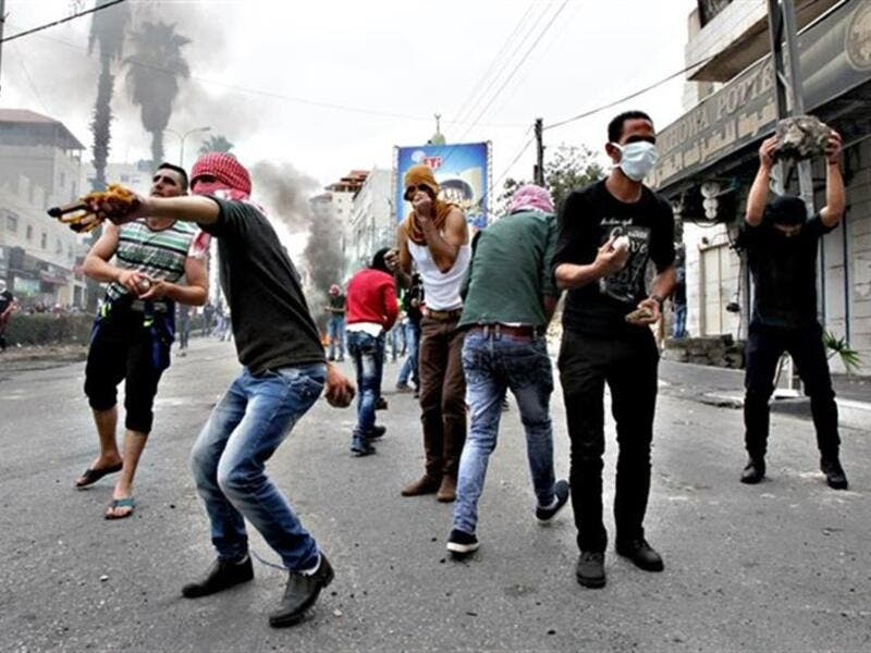Palestinian stone throwers clash with Israeli security forces following Friday prayers on Friday, in West Bank town of Hebron. (AFP/File)