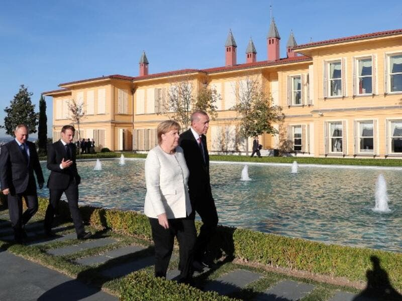 (From L) Russian President Vladimir Putin, French President Emmanuel Macron, German Chancellor Angela Merkel, and Turkish President Recep Tayyip Erdogan walk in the garden of the Vahdettin Mansion in Istanbul, on October 27, 2018. (Kayhan OZER / POOL / AFP)