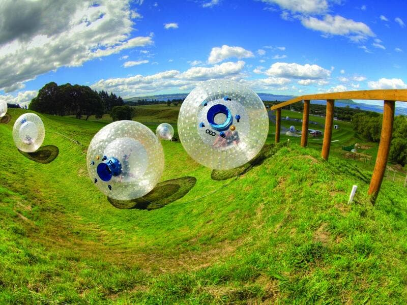 Roll Down A Hill In An Inflatable Ball In New Zealand: e are put inside enormous inflatable plastic balls and then pushed down hills. Apparently, it's big in New Zealand, where riders volunteer to be pushed down hills in these plastic balls, which have no controls and offer no way to stop. (stayathomemum.com)