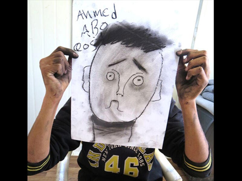 Ahmed nailed the eyebrow lesson, perfectly communicating confusion in his over-sized self portrait. By the end of this session, the black charcoal drawing sticks left the crew looking like coal-miners.