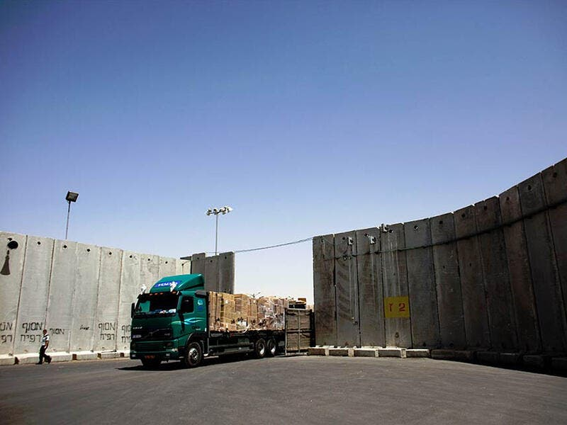truck at israeli checkpoint barrier
