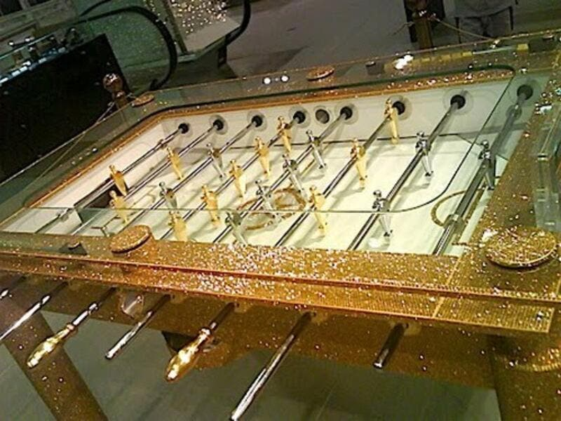 Gold Football Table with Crystal Encrusted on Top (sujitheie.blogspot)