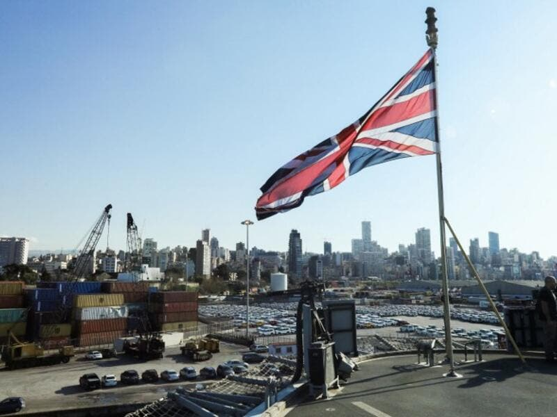 The Union Jack flies from the British Royal Navy's HMS Ocean (L12) amphibious assault ship and helicopter carrier as it lies docked in the port of Beirut. (AFP/Anwar Amro)