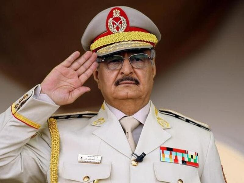 Khalifa Haftar salutes during a military parade in the eastern city of Benghazi. (AFP/ File)