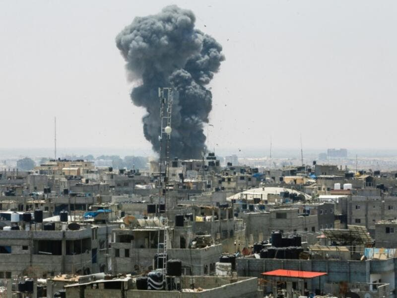 A heavy smoke cloud rises following an Israeli air strike in the southern Gaza Strip city of Rafah on July 14. (AFP)