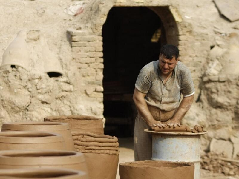 Iraqis making clay pots in Najaf on November 11, 2018. Pottery has deep roots in Iraq, where ancient civilisations turned to clay to build their homes, shape their cooking utensils, and even make their ovens.