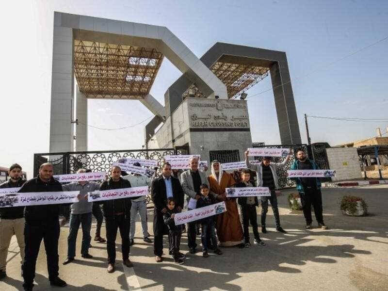 Palestinians protest against the closure of the Rafah crossing point between Egypt and the southern Gaza Strip and the Israeli blockade on the territory, on January 24, 2019 in Rafah. 