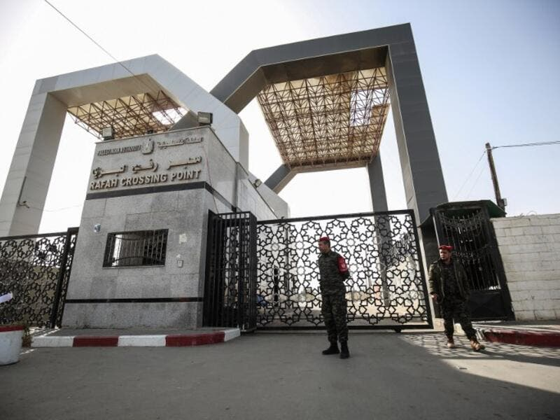 Palestinian security forces loyal to Hamas stand at the Rafah crossing point between Egypt and the southern Gaza Strip on January 24, 2019 in Rafah. 