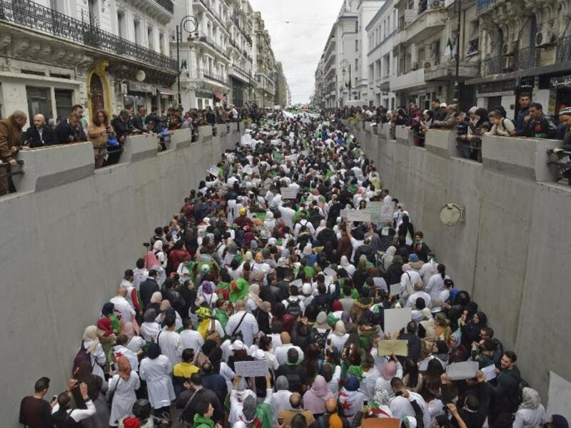 Algerians take part in a demonstration in the capital Algiers against President Abdelaziz Bouteflika on March 19, 2019. (RYAD KRAMDI / AFP)