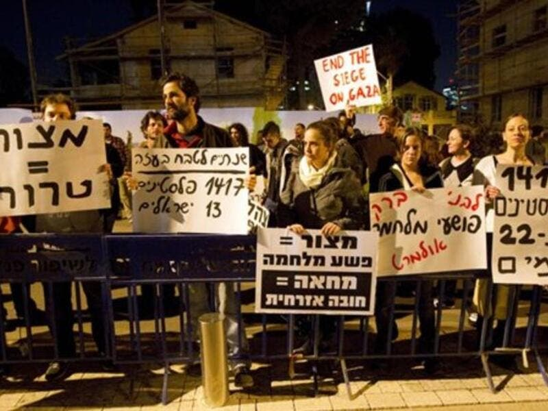 Around a hundred pacifist and leftist Israelis, holding up placards against the blockade imposed by Israel on Gaza since 2007, demonstrate outside the Jewish state's ministry of defense in Tel Aviv.