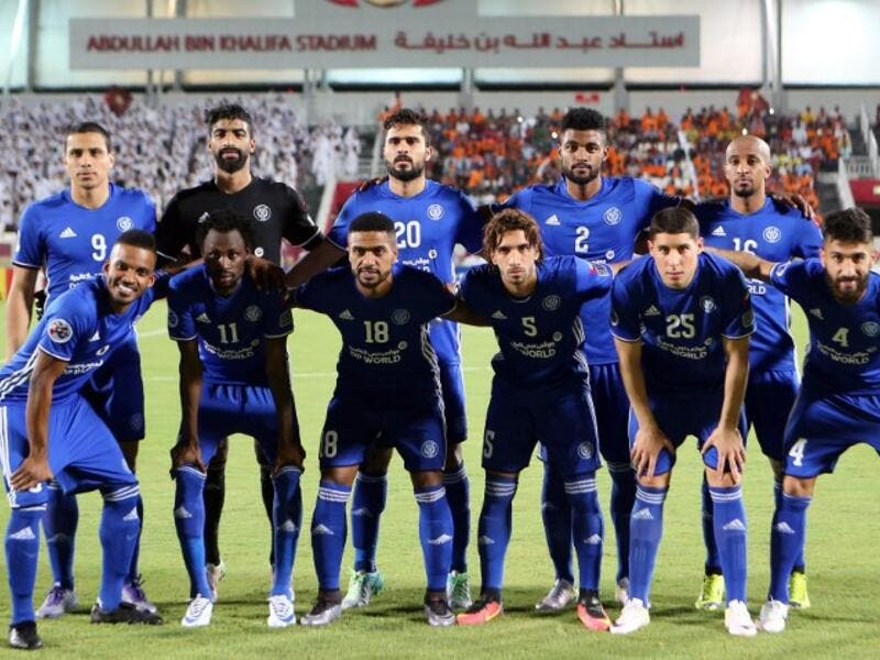 Al-Nasr's starting eleven pose for a group picture during the Asian Champions League quarter-final football match between Qatar's El-Jaish and UAE's Al-Nasr at Abdullah Bin Khalifa Stadium in Doha on August 24, 2016.