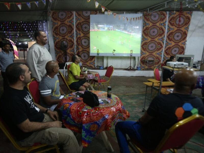 Egyptians watch a football match of the Euro 2016 on June 20, 2016 in the Omani capital Muscat.