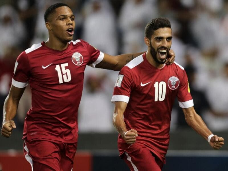 Qatar's Hasan al-Haydos (R) celebrates after scoring a penalty during the 2018 World Cup qualifying football match between Qatar and Syria at the Jassim Bin Hamad Stadium in Doha on October 11, 2016.