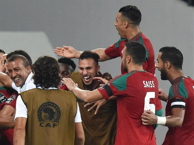 Morocco's players celebrate their third goal during the 2017 Africa Cup of Nations group C football match between Morocco and Togo in Oyem on January 20, 2017.