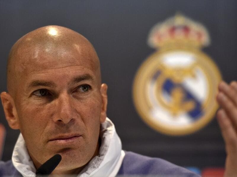 Real Madrid's French coach Zinedine Zidane gestures during a press conference at Valdebebas training ground in Madrid on April 22, 2017, on the eve of the Spanish League Clasico football match Real Madrid CF vs FC Barcelona.