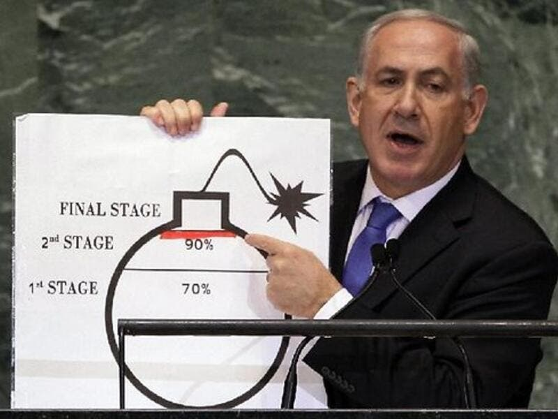 Benjamin Netanyahu shows an illustration as he describes his concerns over Iran's nuclear ambitions during his address to the 67th session of the United Nations General Assembly last September. [AP]