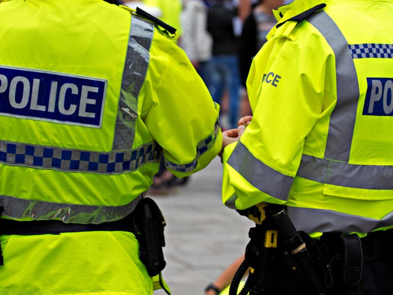 British Police Officers in high visibility uniform on crowd control. (Shutterstock/ File Photo)
