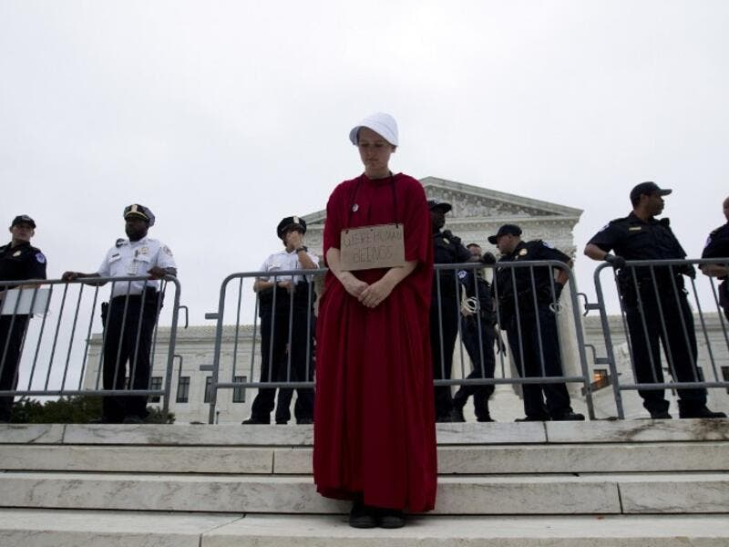Payton Sander wearing a dress from The Handmaid's Tale protests at the steps of the US Supreme Court to protest against the appointment of Supreme Court nominee Brett Kavanaugh. (Jose Luis Magana / AFP)