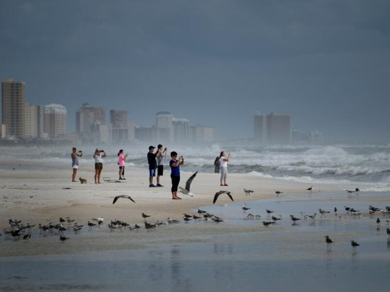 People look out to the Gulf of Mexico as Hurricane Michael approaches October 9, 2018 in Panama City Beach, Florida Hurricane Michael strengthened to a Category 2 storm with winds over 100 miles per hour on Tuesday. (Brendan Smialowski / AFP)