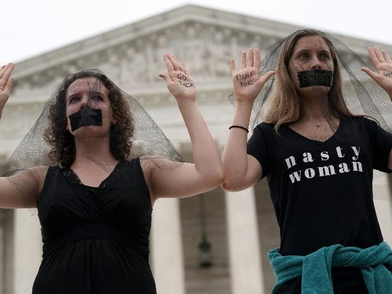 Activists occupy the front steps of the U.S. Supreme Court to protest against the confirmation of Judge Brett Kavanaugh to the Supreme Court October 6, 2018 in Washington, DC. (Alex Wong/Getty Images/AFP)