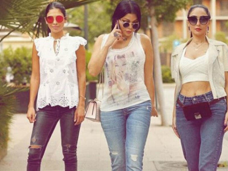 The Lebanese diva and her sisters sported casual looks with denim tight pants