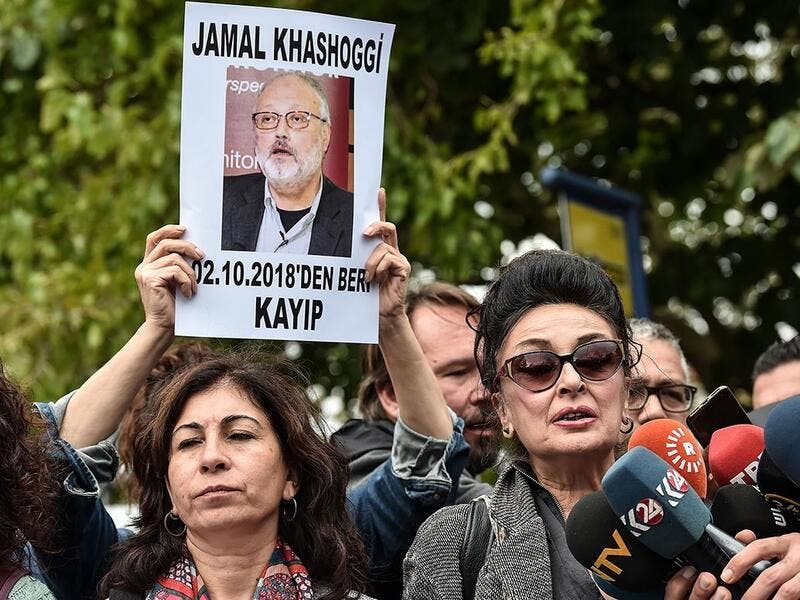 Vice president of the Turkish Human Rights Association (IHD) Eren Keskin (R) speaks to journalists during a demonstration in front of the Saudi Arabian consulate on Tuesday in Istanbul. (AFP/File)